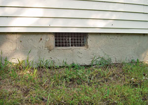 Open crawl space vents that let rodents, termites, and other pests in a home in Glencoe